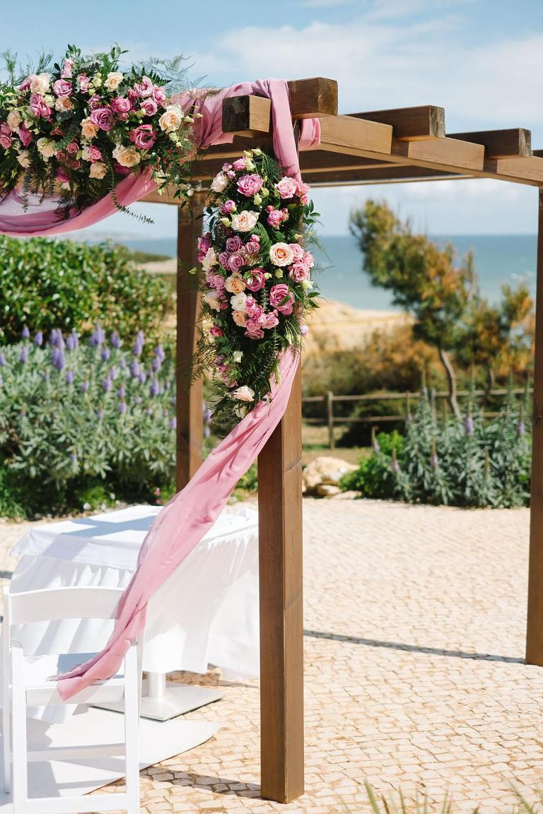 Floral Arch suites alba resort Viral Wedding Flowers pink yellow rose garden, ceremony backdrop, flower arc, garden wedding, pink wedding inspiration , blush wedding inspiration www.jesuscaballero.com