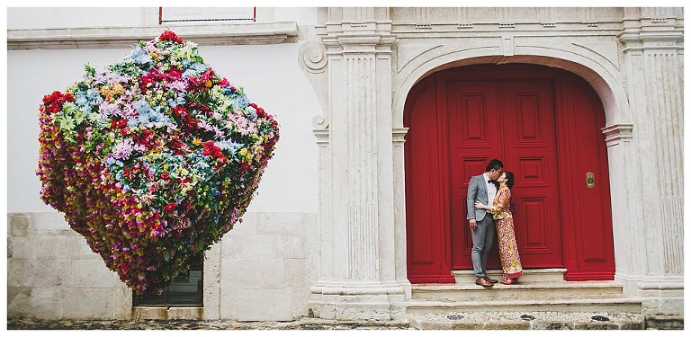 a couple kiss after elopement in Belmonte Palace red door with bride with red chinese dress